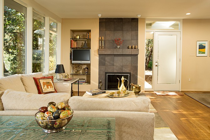 At slightly over 900 square feet, the primary living area the Herre's remodeled home in Hollin Hills is comparatively small. But designer Jon Benson's wall elevations employ texture and color that make the space feel expansive.