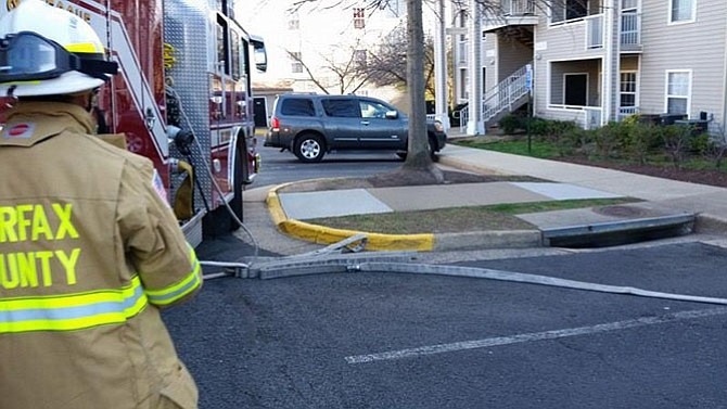 Firefighters from Station 38 undergo training at a local apartment complex.