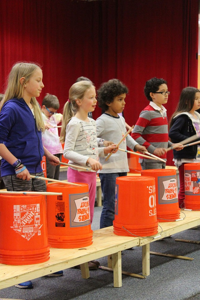 The evening performance showcased the bucket drumming skills of children from Clearview Elementary School (pictured above) as well as children from Herndon Elementary School. The after school programs not only taught drumming, but life skills such as respect for others and cooperation.