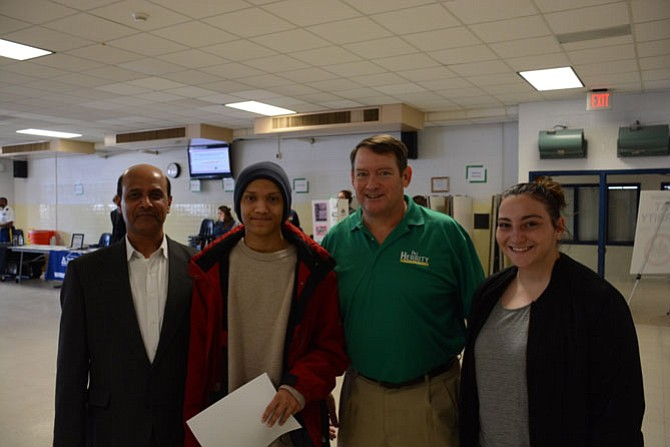 From left, Rokan Ahamed of Burke and his son Yusuf, supervisor Pat Herrity (R-Springfield) and Colleen Burger of West Springfield at the third teen job fair, held April 1 at West Springfield High School.