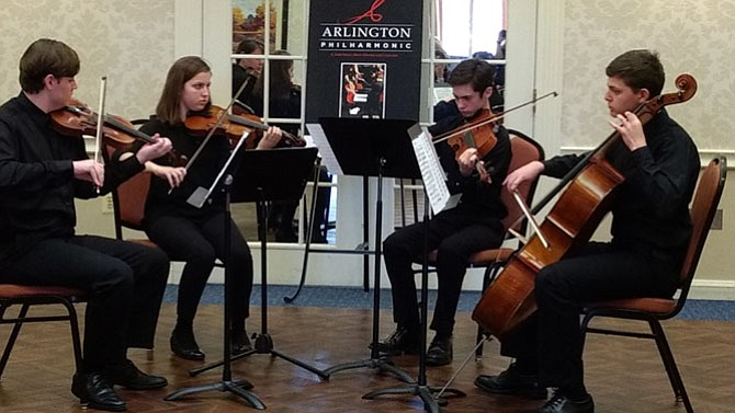 From left: Maxwell Herrmann and Malina Nelson play violin with Billy Holtz on the viola and Jacob Levy on the cello.