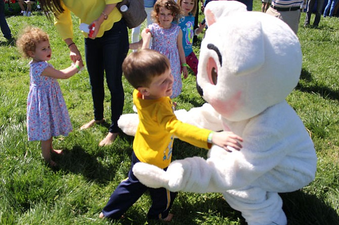 Conner Donlon, 3, of Reston gets a hug from the Easter Bunny at the Great Falls Annual Children's Spring Festival.
