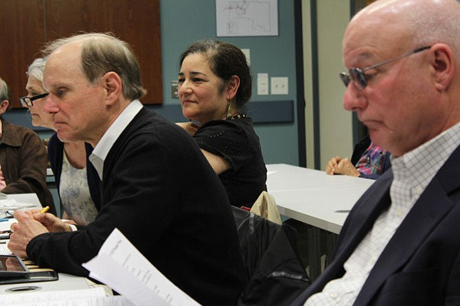 McLean Citizens Association Committee Chairs Louise Epstein, Education and Youth; Dale Stein, Budget and Taxation; and Patrick Smaldore; Public Safety; discuss the resolution that their committees drafted at the MCA's Board of Directors meeting on Wednesday, April 5.