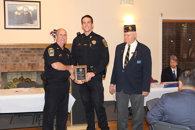 From left, Chief James Morris, Officer Andrew Slebonick, 1st Vice Commander Phil Dunn.