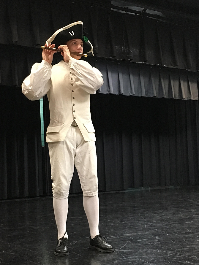 Eighth grade student Will Settle represents the Yorktown Fife and Drum Corps.