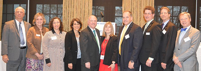 The April 6 Economic Outlook summit hosted by the Mount Vernon-Lee Chamber of Commerce and Southeast Fairfax Development Corporation also featured (from left) Dr. Gerald L. Gordon, Fairfax County EDA; Jane Gandee, Chamber Chairman; Rebecca Cooper, Washington Business Journal; Ann B. Macharas, Federal Reserve Bank of Richmond; Dr. Terry Clower, GMU Center for Regional Analysis; Edythe Kelleher, SFDC executive director; Mark Viani, SFDC Vice President; Scott Stroh III, Chamber President; Robert Stalzer, Fairfax County Deputy Executive; and Dr. Frank Nothaft, CoreLogic.