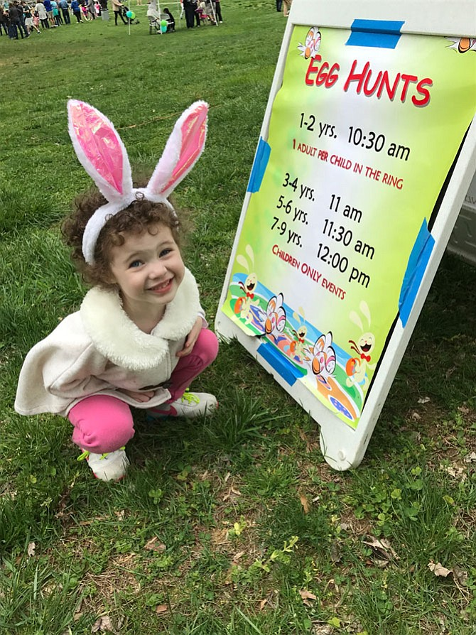 "Anna Ford was delighted with the sign directing families to the Easter Egg Hunt at Nottoway Park held Saturday, April 15. Michael Ford, Anna's dad, said, ""Anna came last year and got a little. This year, her candy palate has matured."""