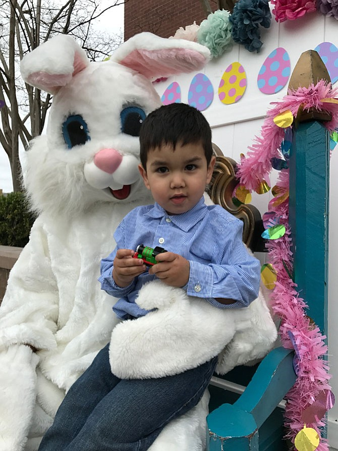 Ethan J. Meller, 2, climbed up on the Easter Rabbit's lap at the Herndon Easter Egg Hunt produced by Parks and Recreation. The event was held Sat., April 15 on the Town Green behind the Municipal Center.