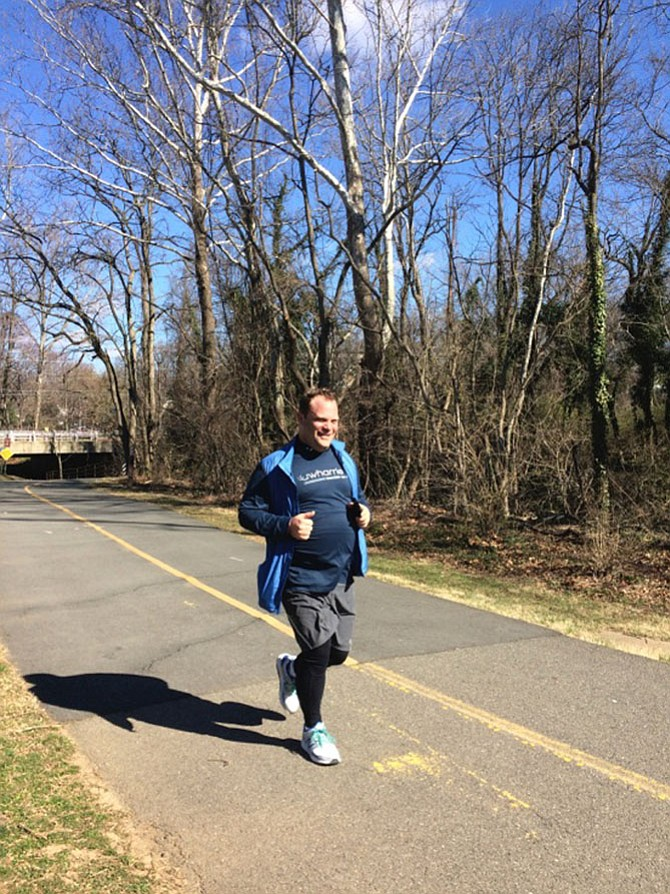 Andrew Schneider coming in with a smile — 5 miler.