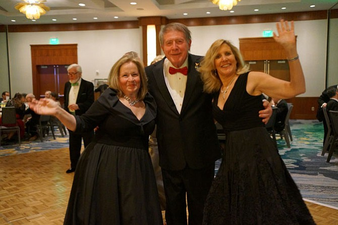 Cindy and Greg Golubin take to the dance floor with Elizabeth Wilmot at the Symphony Orchestra League of Alexandria's 30th annual ball and auction March 18 at the Westin Alexandria Hotel.