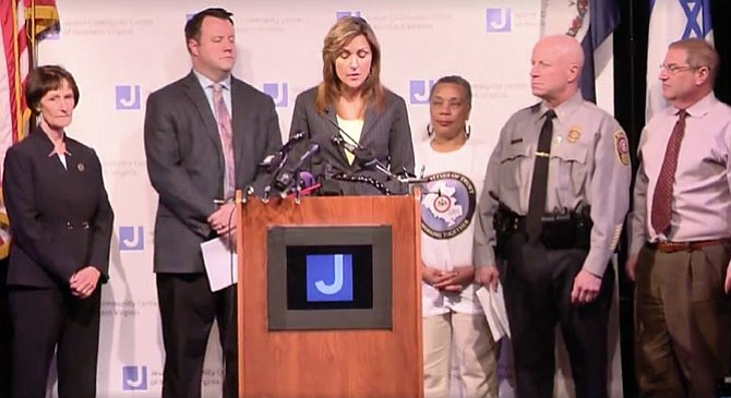 On April 13, Fairfax County Police public relations bureau director Julie Parker (center) announces the arrest of Dylan Mahone of Annandale in connection with three hate-motivated incidents at the Jewish Community Center of Virginia and Little River United Church of Christ.