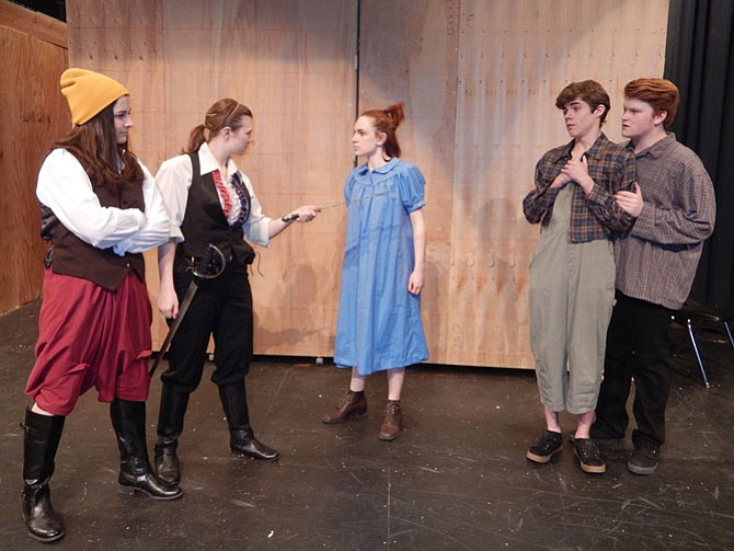 "From left: Meryn Holtslander, Caroline Grass, Caroline Orejuela, Andrew Black and Jacob Lamb rehearse a scene where a pirate captain searches for a treasure trunk of ""starstuff."""