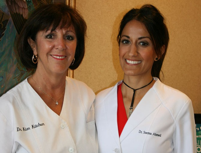 """From left are Dr. Kim Kitchen and Dr. Seema Ahmed, at Old Town Smiles, 500 Montgomery St., Alexandria. Together, """"We try to and do at least four to six full mouth makeover cases every year,"""" said Kitchen."""