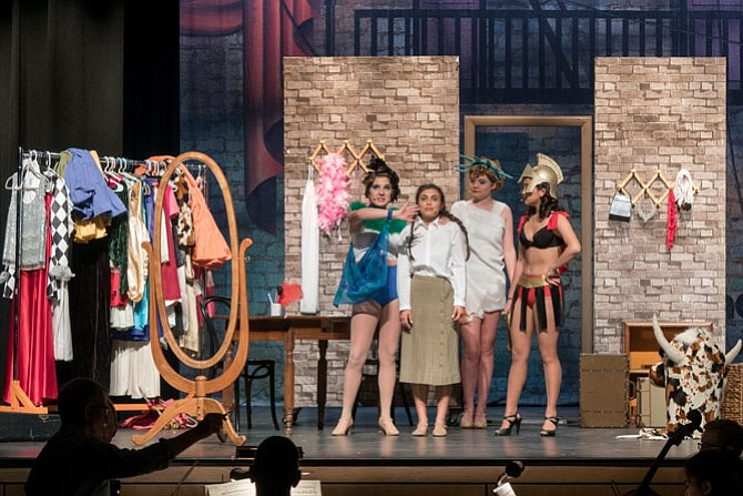 "Three strippers, played by students Elenitsa Sgorous (left), Anneka Noe (center, right) and Yoona Lee (right), teach Louise, played by junior Jessica Peros (center, left), the ropes of striptease in the number ""Gotta Get a Gimmick"" in Langley High School production of musical, ""Gypsy."""