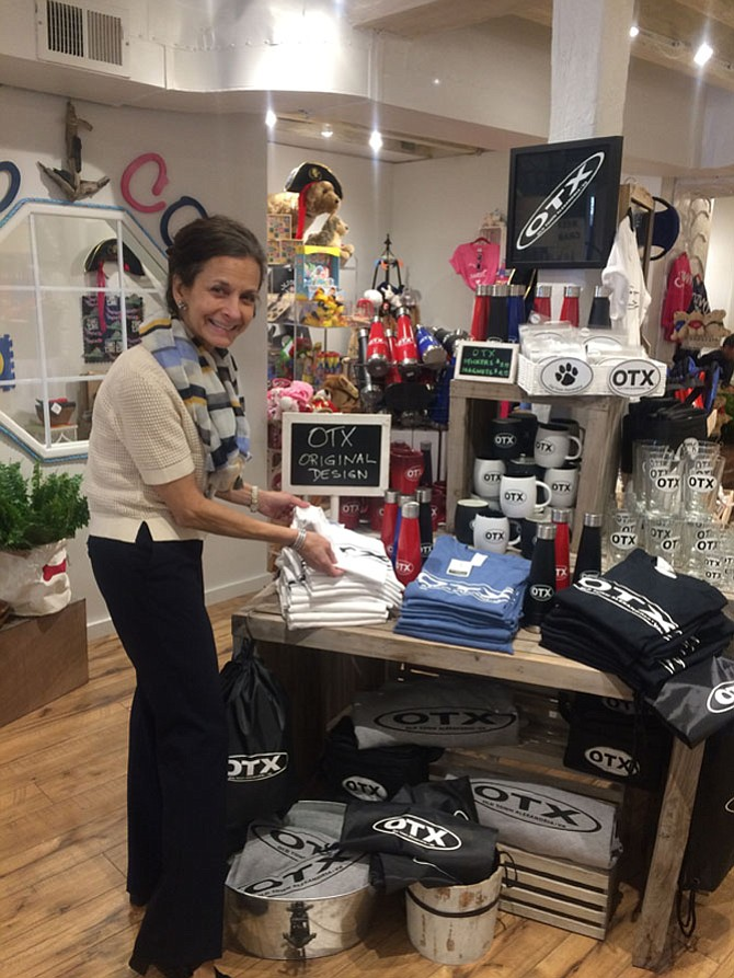 Owner Valeria Ianieri adjusts a merchandise display April 20 at The Old Town Shop at 105 S. Union St. The shop opened last month and will celebrate with a grand opening April 28.