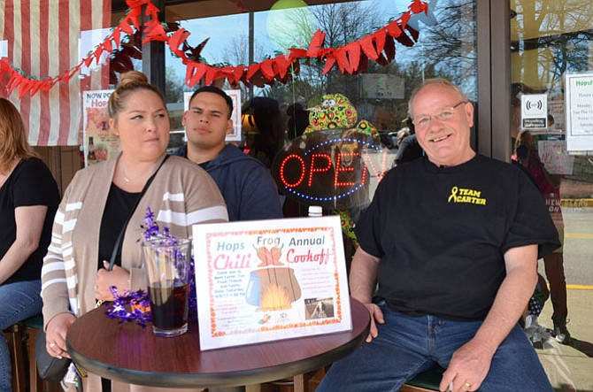 From left, Tiffany and Silfredo Sosa (aunt and uncle of Carter Dean) of Lorton, and Dennis Dean (Carter's grandfather) attend the Hopsfrog Grille chili cook-off April 8.