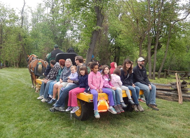 Children enjoy a hayride on the grounds during last year's event.