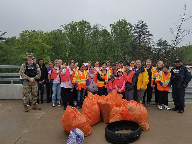 Volunteers from the Mount Vernon-Lee Chamber of Commerce and Fort Belvoir Garrison Command partnered to clean up trash from around the Jeff Todd Way and Mount Vernon Memorial Highway intersection on April 22.