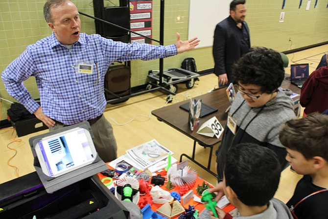 Herndon Elementary School sixth-grade students peruse objects that were created by Bruce Wyman of 3D Herndon and his 3-D printer during the career fair.