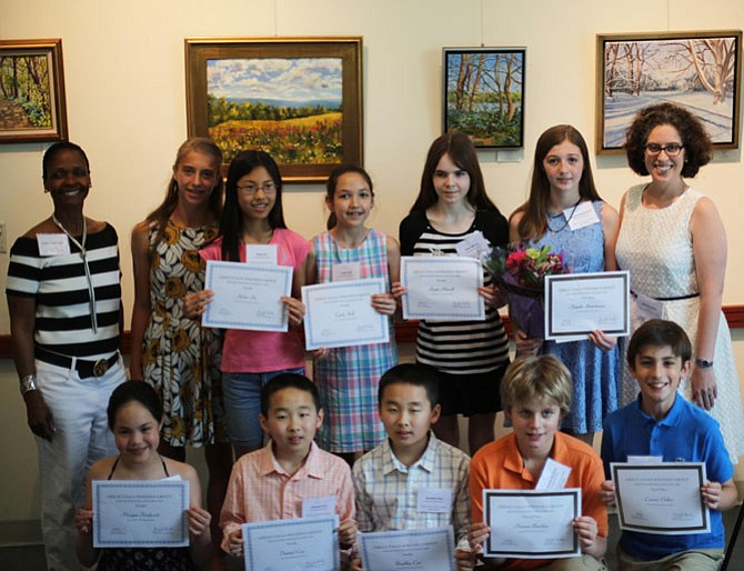 Great Falls Writer's Group founder Kristin Clark Taylor believes in the value, worth, and staying power of the students' words. She told the finalists she hopes the writing contest experience helps them recognize the impact of their written words for the rest of their lives. Pictured in the top row are Taylor, guest speaker Sophie Tedesco, Helen Fu, Carly Hill, Katie Merrill, first-place winner Natalie Hutchinson, and Friends of the Great Falls Library president Michelle Miller. Bottom row: Morgan Frederick, Danniel Cao, Bradley Cao, second-place winner Thomas Buckley, and third-place winner Connor Oakes. Not pictured is Ann Shen.