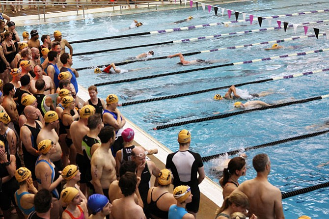 Competitors take to the pool for the first event of the day while others watch while waiting for their turn.