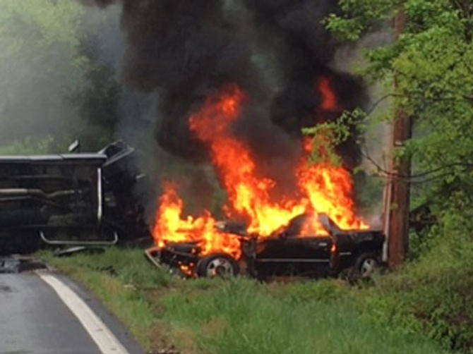 A car crash near the intersection of River Road and Seneca Road left a car engulfed in flames.