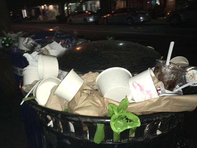 A recent Sunday night in Del Ray shows take-out containers piled up in the neighborhood's full trash cans.