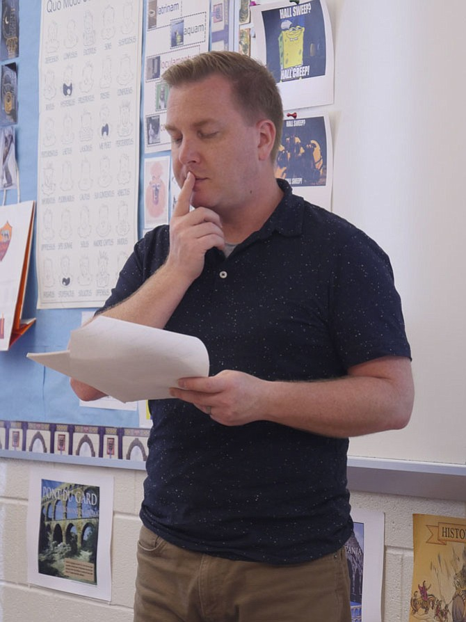 "Justin Redpath, Latin teacher at T.C. Williams High School, ""gets down in the dirt"" with his class on analyzing Roman poems — what is the author trying to say and how does it translate into our lives today."