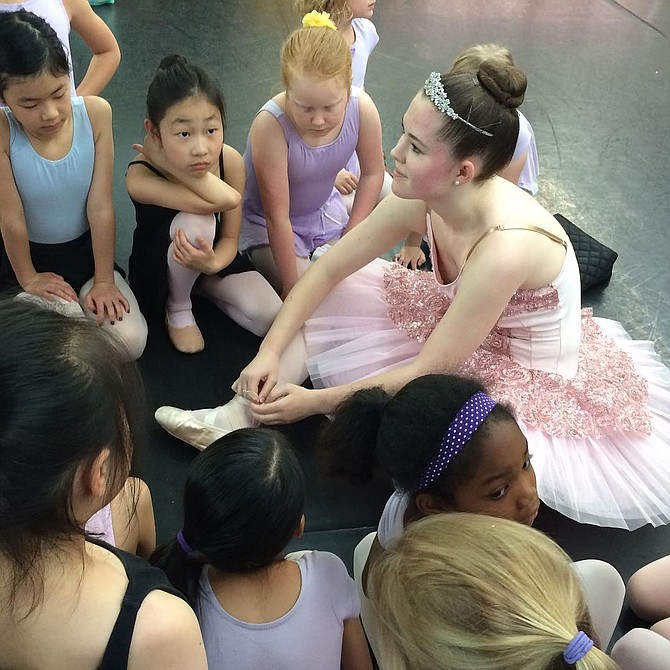 "Mary-Shea McDowell shares ballet secrets with youngsters in Arlington, as she practices for her role as the princess in the full-length ballet, ""The Dancing Princesses,"" on Saturday, May 6 at Kenmore Middle School Theater on Carlin Springs Road in Arlington. Two performances will be held at 1 and 7 p.m.  Visit www.CuppettPAC.com or call 703-938-9019."