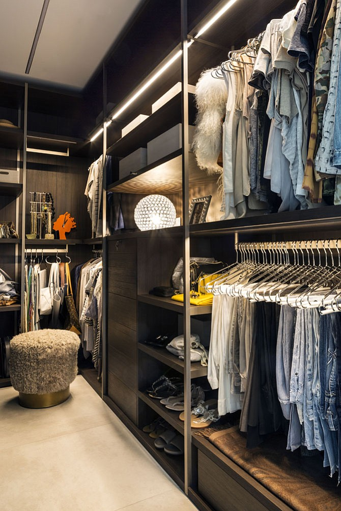 Open shelving for storing shoes and handbags are among the features that designer Julia Walter recommends for walk-in closets.