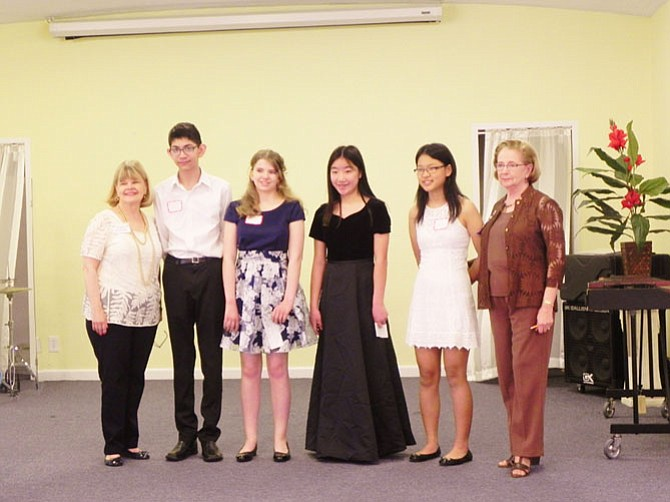 Student musicians pose with 2017-2018 Woman's Club President Kathryn Mackensen (far left) and current Woman's Club President Joan Morton (far right).