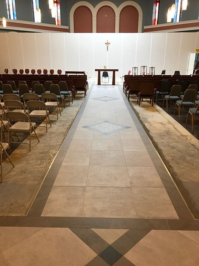 St. Veronica's center aisle tile work has been installed.