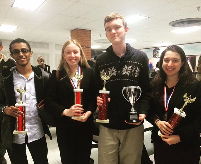T.C. Williams High School Varsity Debate team co-captains Jay Falk, right, and Victoria Peace, second from left, will be featured in the May 22 Agenda:Alexandria discussion on gun control.