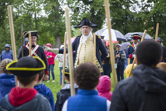 General George Washington inspects Continental Army troops during the Revolutionary War weekend at the Mount Vernon estate May 6 and 7.