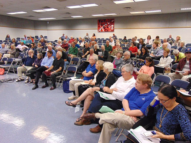 About 100 people attended the South Flow Alliance Community Action Meeting on Wednesday, May 10, at Walt Whitman Middle School in Alexandria.