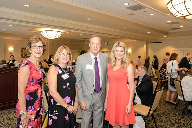 Assistance League of Northern Virginia's president and fundraiser chair pose with event sponsor ShounBach and featured guest speaker at the nonprofit's annual Spring Fundraiser.  From left are Linda Shilts, Linda Stephens, Al Bonin, and Kimberly Suiters.