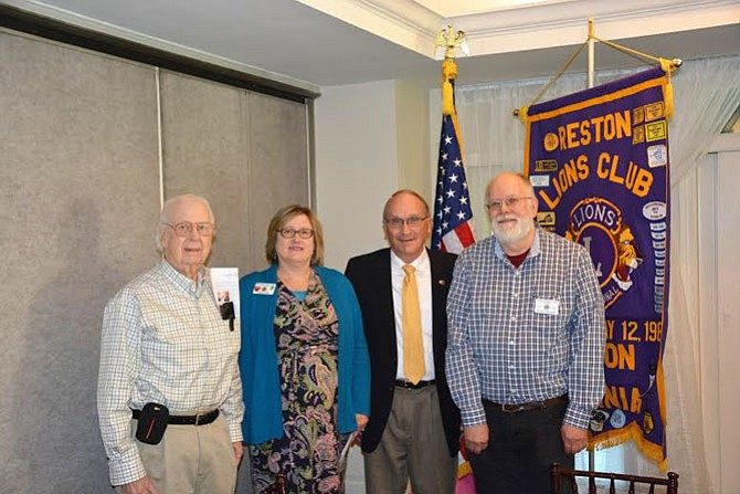 From left: Gerry Washburn, Program Chairman; Anne Ryan, Past President; Colonel Nickisch and Patrick McCann, Club President.