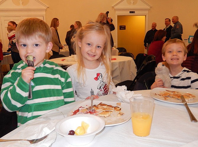 The Prentice siblings (from left) Luke, Emma and Connor, enjoy themselves at last year's pancake breakfast.