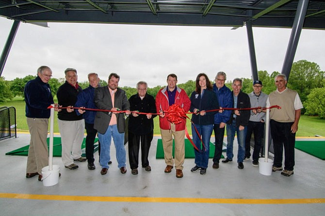 Local officials cut the ribbon on the new golf facilities at Burke Lake just in time for the summer golf season.