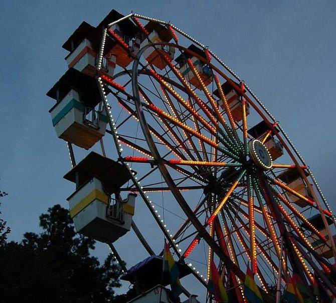 The Ferris wheel lights up the evening sky in Arlington.