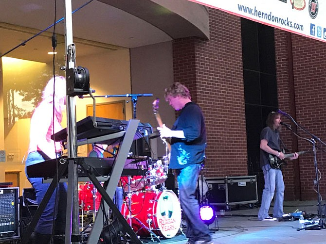 The 23rd season for the Town of Herndon's Friday Night Live! presented by Volkswagen Group of America began May 5 with The Reagan Years (TRY), a band of five seasoned musicians who originated the 80s multi-band tribute concept. TRY featured Karen Ellison - keys, vocals, Stephan Scott Lay - vocals, acoustic Guitar, Glenn Riley - guitars, vocals, Jody Lewis - bass, vocals and Sy Seyler - drums, vocals.