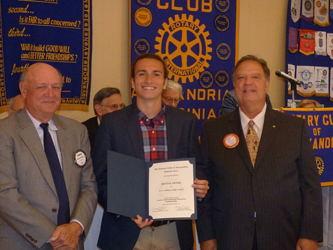 "T.C. Williams High School senior Matias Hendi, center, is presented a scholarship by the Alexandria Rotary Club May 23 for his design of a ""tiny house"" for use by college students. Making the presentation at Belle Haven Country Club are Rotarians Charles Ballou, left, and Jim Carmalt."