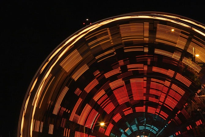 At night, the spinning wheel lights up the sky.