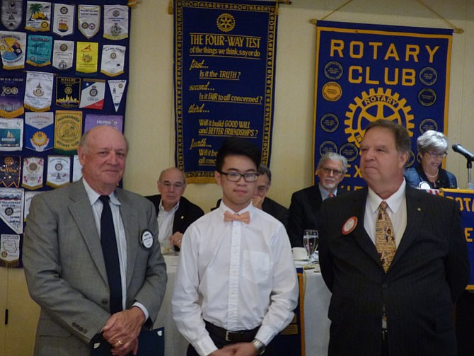 Edison High School senior Vincent Mai, center, is presented a scholarship by the Alexandria Rotary Club May 23 for his achievements in the Advanced Network Administration program. Making the presentation at Belle Haven Country Club are Rotarians Charles Ballou, left, and Jim Carmalt.
