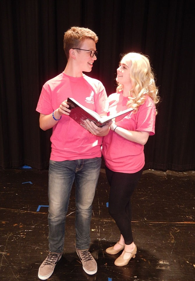 """In Westfield's """"Legally Blonde: The Musical,"""" John Henry Stamper (Emmett) and Molly Van Trees (Elle) share a tender moment while studying."""
