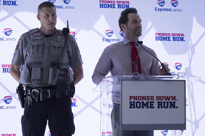 McLean High School Resource Officer Scott Davis and Nick Corsi, systems of support advisor for the school, pitch their support for the campaign as the first speakers of the event.