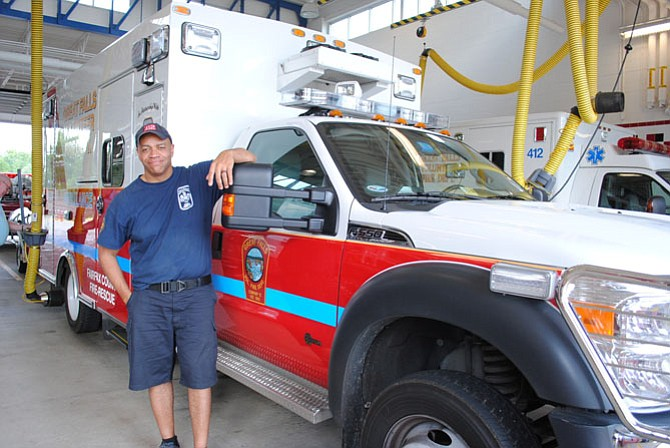 Michael Moore, Master Technician, stands by one of the ambulances he drives.