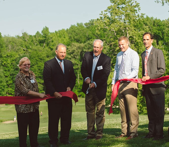 Those helping to cut the ceremonial ribbon upon the opening of Mount Vernon Country Club's eco-friendly golf course include MVCCA's Cathy Ledec (from left), club General Manager Pete Van Pelt, club President Lou Haley, Supervisor Jeff McKay (D-Lee), and Supervisor Dan Storck (D-Mount Vernon).