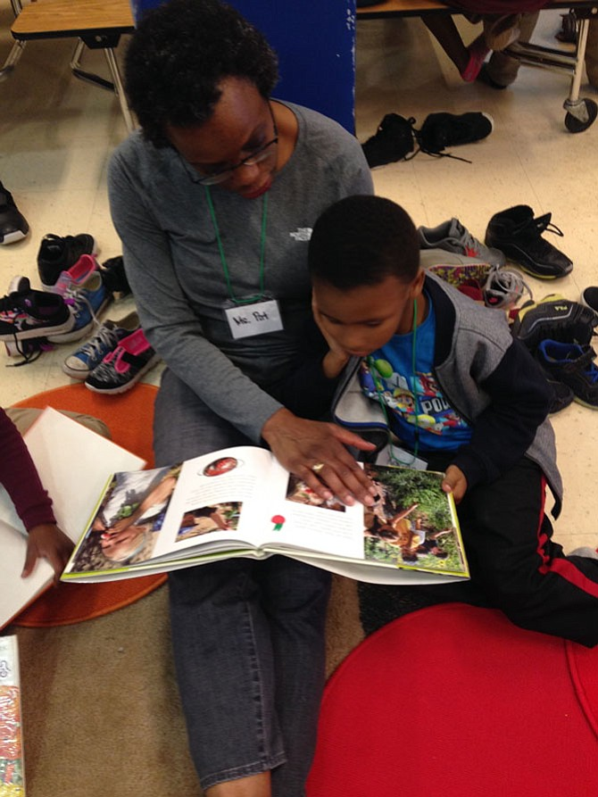 Learning to read at ARHA. Children who find reading challenging by age 10 (that's fourth grade) are four times more likely to drop out of high school, according to The Reading Connection.