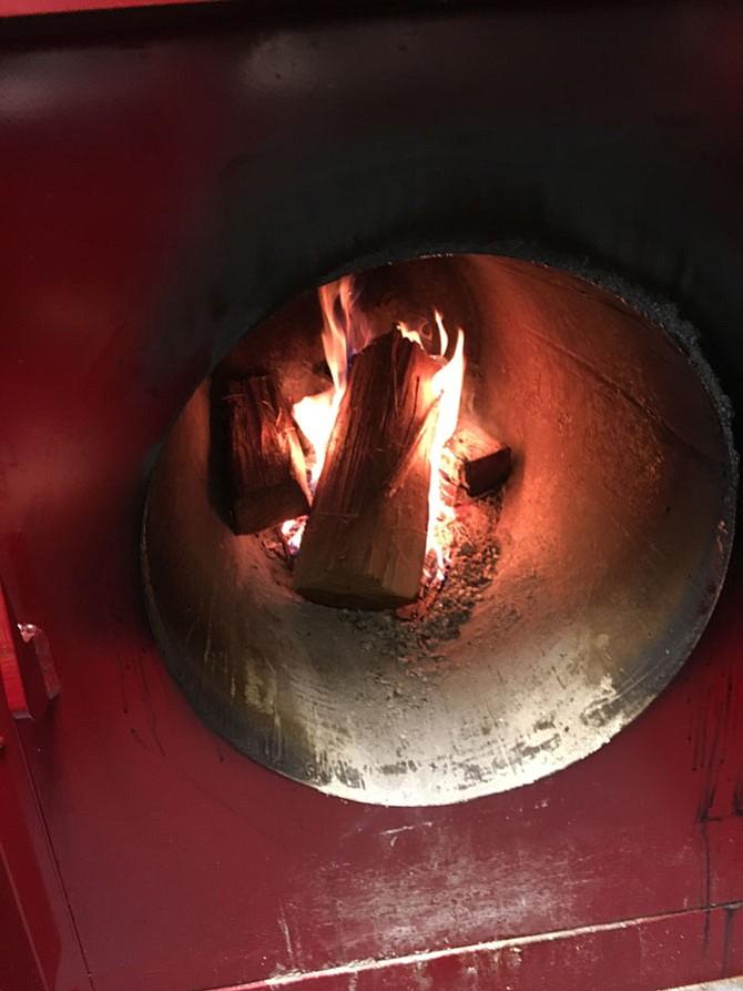"Willard's jewel is their custom hand built ""Oyler"" hickory wood BBQ pit."